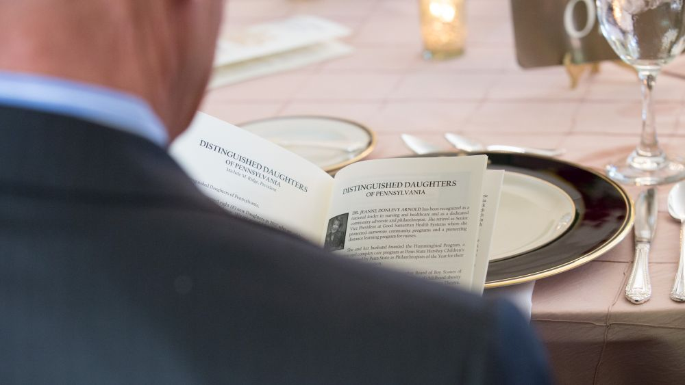 A guest looks over the program